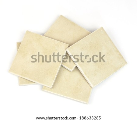 Stack of ceramic tiles. Isolated on white background - stock photo