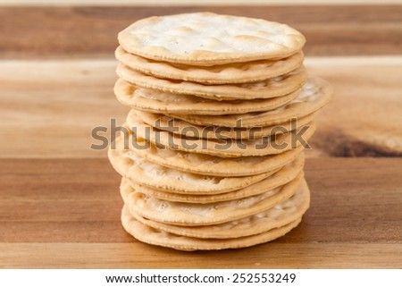 stack of cheese crackers on wooden board