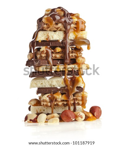 Stack of Chocolate and caramel syrup poured on white background - stock photo