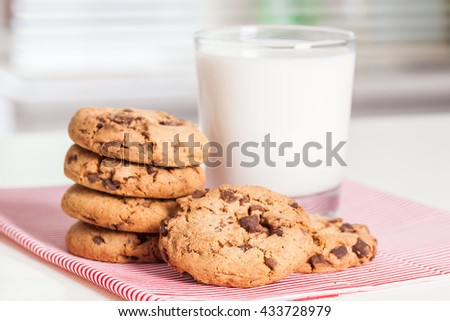Stack of Chocolate chip cookie and glass of milk. Selective focus. - stock photo