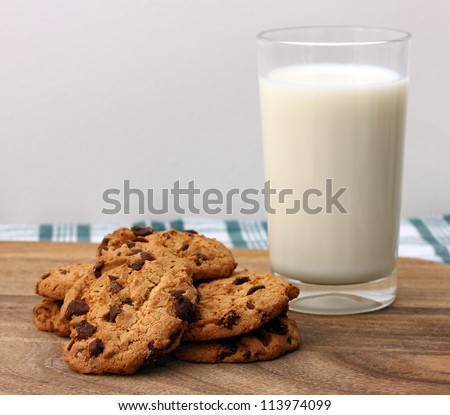 stack of chocolate cookies with milk - stock photo