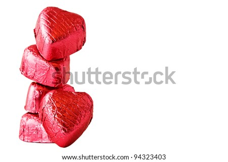 Stack of Chocolate heart candies on white background - stock photo