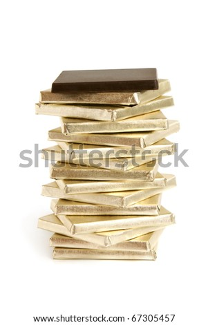 Stack of chocolate pieces on a white background - stock photo