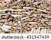 Stack of chopped firewood prepared for winter. - stock photo