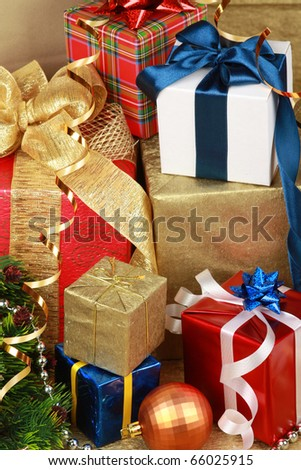 Stack of christmas gift boxes with bow and balls - stock photo