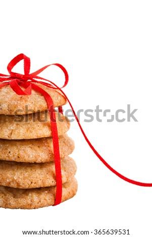 Stack of christmas gingerbread cookies tied with red ribbon isolated on white - stock photo