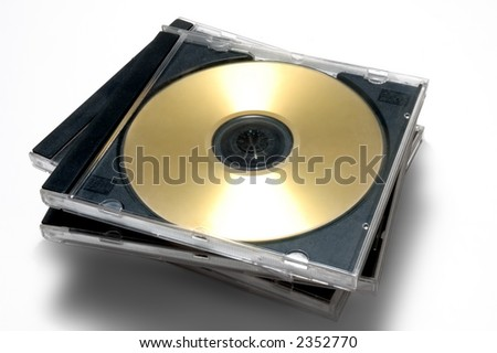 Stack of classic CD/DVD case with golden disc - stock photo