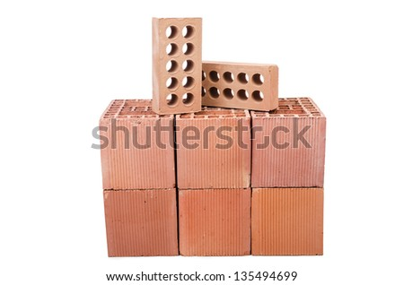 Stack of clay bricks isolated on white - stock photo