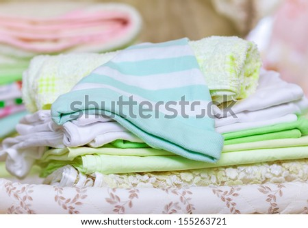 stack of clean baby clothes - stock photo