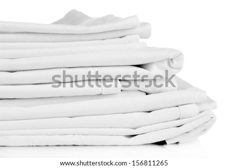 Stack of clean bedding sheets isolated on white - stock photo