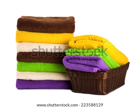 Stack of clean fresh towels isolated on white background - stock photo