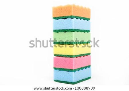 Stack of cleaning sponges on a white background.