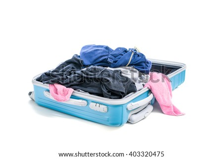 stack of clothes in open travel bag isolated on white background - stock photo