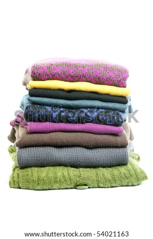 Stack of clothes on white background - stock photo