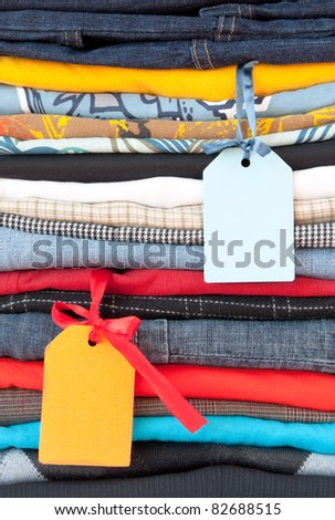 stack of clothing with labels - stock photo