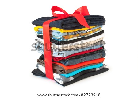 stack of clothing with red ribbon and bow - stock photo