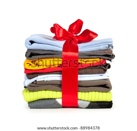 stack of clothing with red ribbon and bow like a gift - stock photo