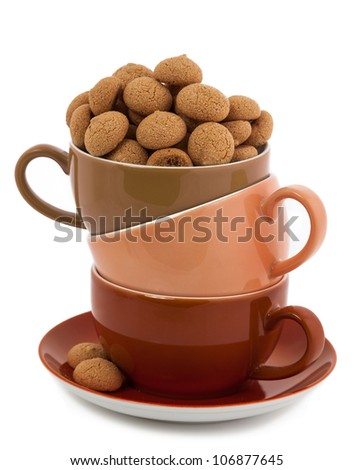 Stack of Coffee Cups whit Amarettini Cookie isolated on white - stock photo