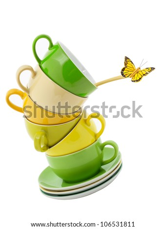 Stack of Coffee Cups whit Butterfly for Balance isolated on white - stock photo