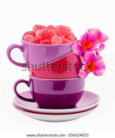Stack of Coffee Cups whit Purple jelly candies isolated on white - stock photo