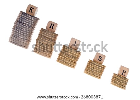 Stack of coins and wood dice with the german word crisis / Euro Crisis - stock photo