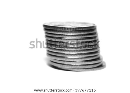 Stack of coins isolated on white background, black and white photo