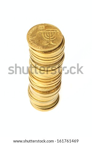 Stack of coins Israeli in shallow DOF isolated on white background - stock photo