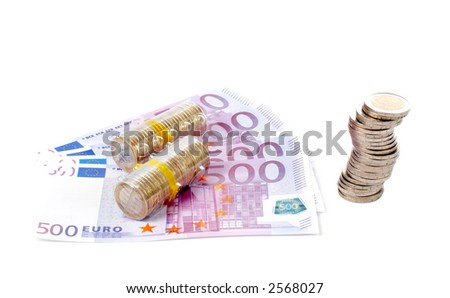 Stack of coins over a euro bills background