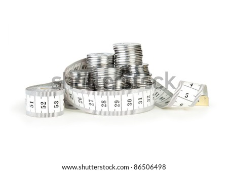stack of coins with tape measuring isolated on white - stock photo