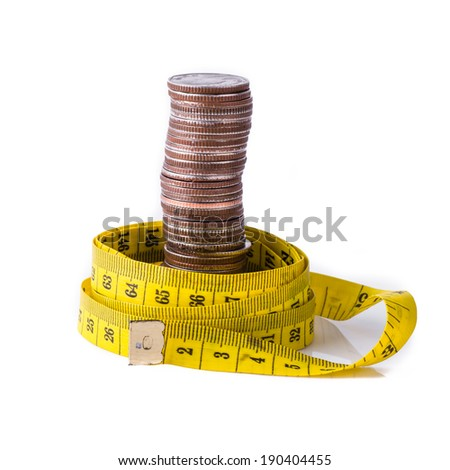 stack of coins with tape measuring isolated on white, selective focus and money concept. - stock photo