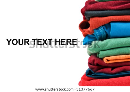 Stack of color clothes stored in rows - stock photo