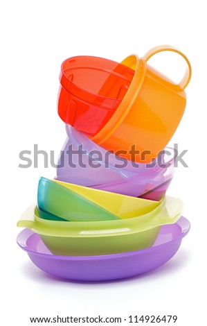 Stack of Color Plastic Bowls isolated on white background - stock photo