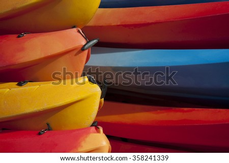 Stack of colored canoes