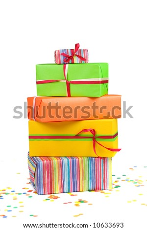 Stack of colored gift boxes and confetti - stock photo