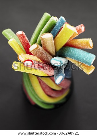 Stack of colored gummy sweet sticks - stock photo