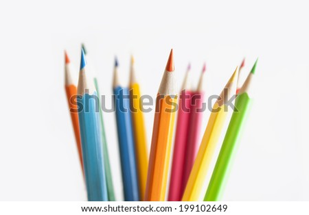 Stack of colored pencils with shallow depth of field. - stock photo