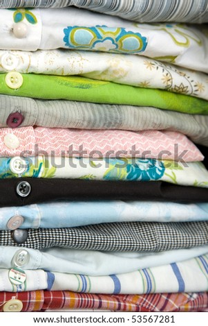 stack of colored shirt, front view, details of buttons - stock photo
