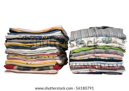 stack of colored t-shirts and shirt, front view, ironed and packed - stock photo
