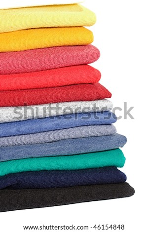 Stack of colored tee shirts on a shelf - stock photo