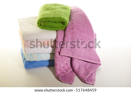 stack of colored towels on a white background