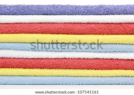 Stack of colorful bathroom towels - stock photo
