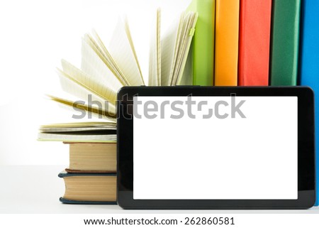 Stack of colorful books and electronic book reader on white background. Electronic library concept. Back to school. Copy space - stock photo
