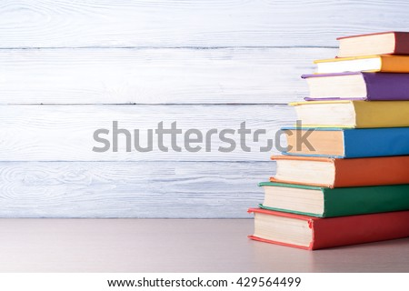 Stack of colorful books. Education background. Back to school. Copy space for text - stock photo