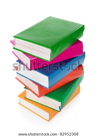 Stack of colorful books isolated over white background