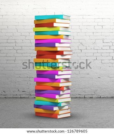 stack of colorful books on brick background - stock photo
