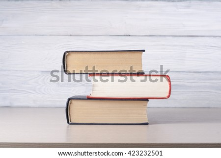 Stack of colorful books on table. Education background. Back to school. Copy space for text. - stock photo