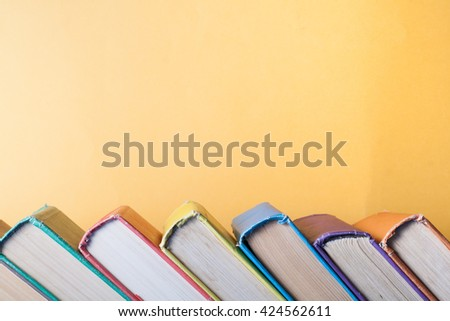 Stack of colorful books on table. Education background. Back to school. Copy space for text - stock photo