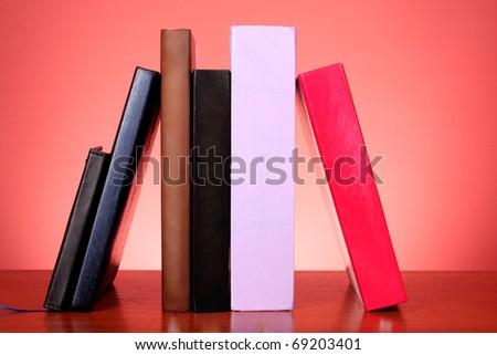 stack of colorful books on the table - stock photo