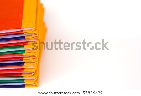 Stack of colorful  books on white background, partial view. - stock photo