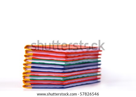 Stack of colorful  books on white background, side view. - stock photo